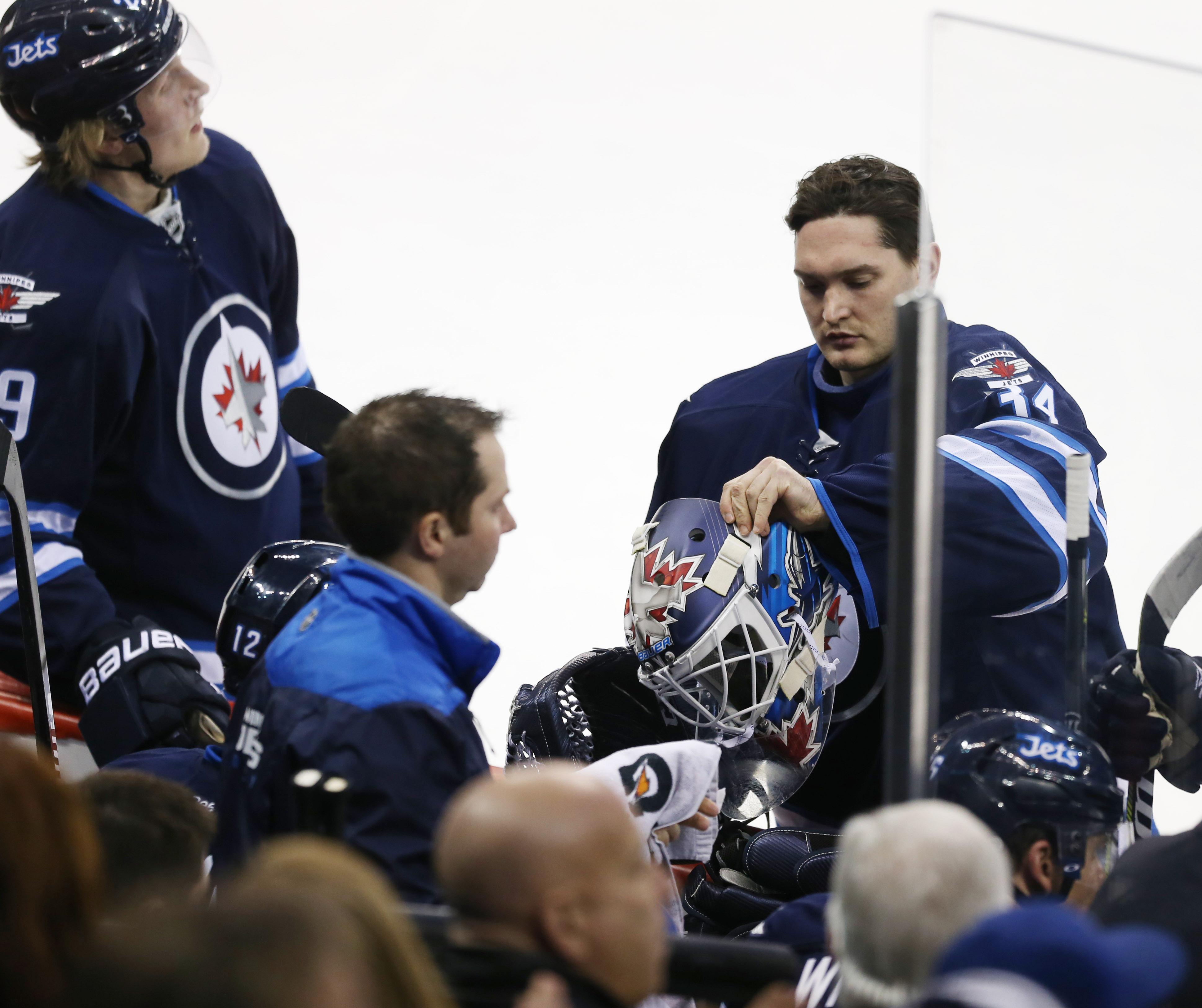Winnipeg Jets goalie Michael Hutchinson (34) prepares to head to the net to replace Winnipeg Jets goalie Connor Hellebuyck (37) during the second period against the Minnesota Wild at MTS Centre.
