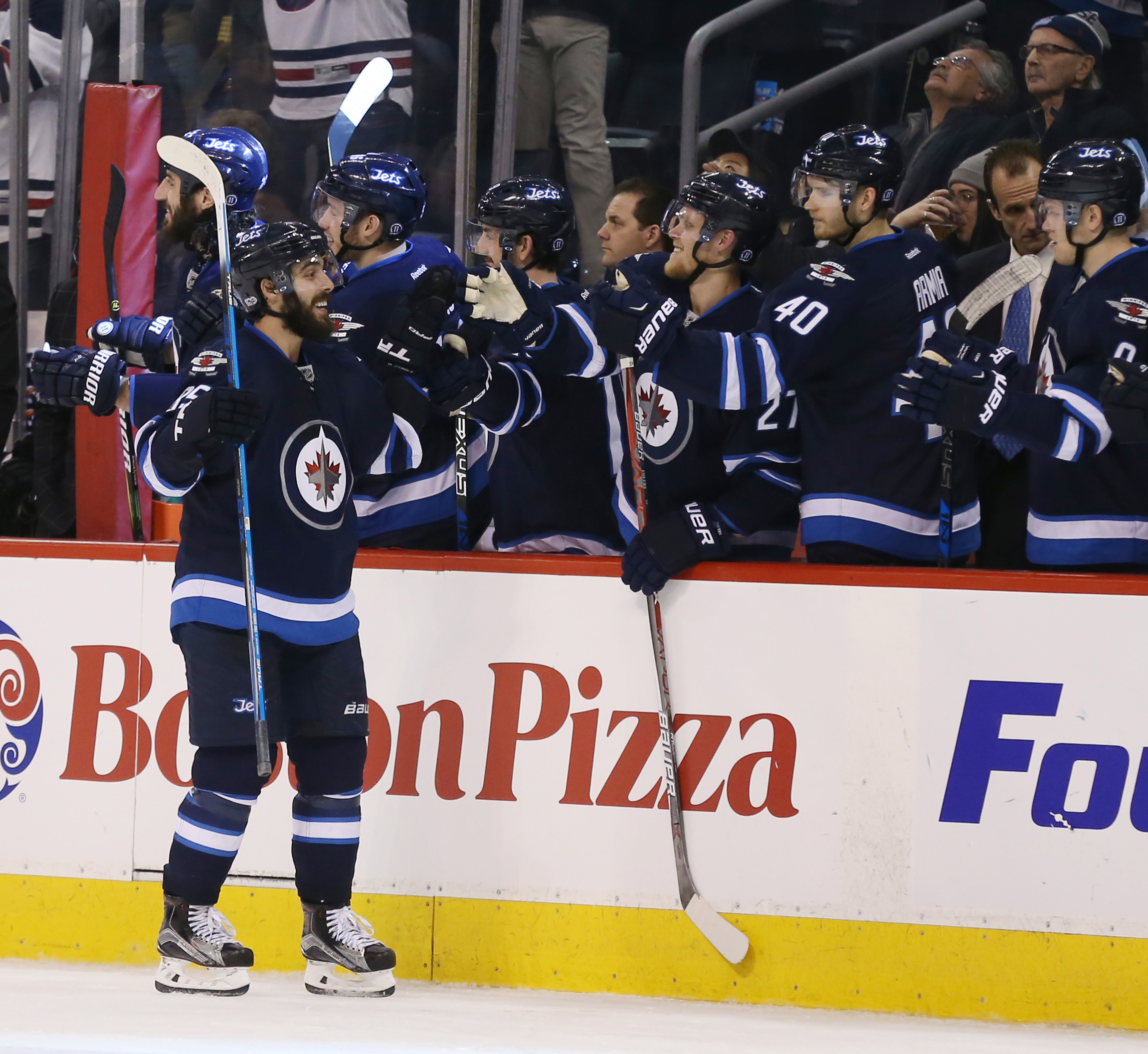 Mar 21, 2017; Winnipeg, Manitoba, CAN; Winnipeg Jets center Mathieu Perreault (85) celebrates with teammates after scoring a goal during the third period against the Philadelphia Flyers at MTS Centre. Winnipeg Jets win 3-2. Mandatory Credit: Bruce Fedyck-USA TODAY Sports